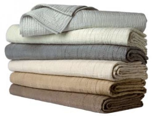 Yves Delorme coverlets.  (my favorite linens ever) I find these colors more soothing.  (Just my opinion).